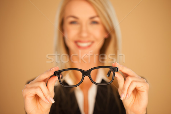 Stock photo: Woman holding out her spectacles