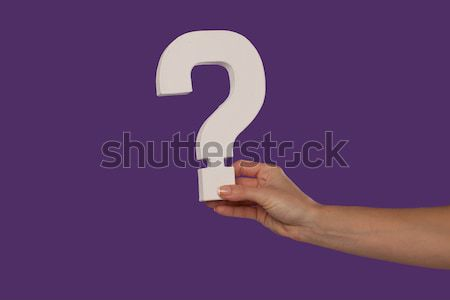 Female hand holding up a question mark from the left Stock photo © stryjek