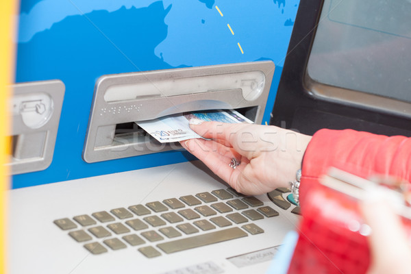 Woman taking banknotes from a bank ATM Stock photo © stryjek