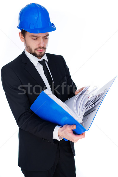 Architect consulting a binder of notes Stock photo © stryjek