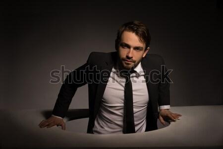 Empresário escalada fora buraco bonito Foto stock © stryjek