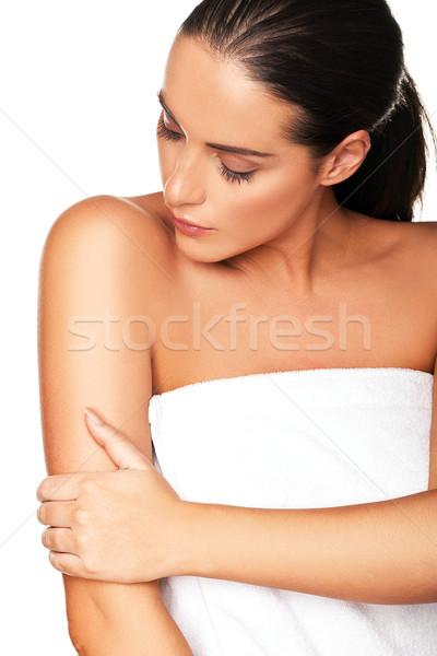 Beautiful woman caressing her arm Stock photo © stryjek