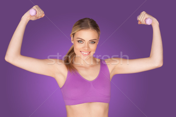 attractive woman exercising with dumbbell Stock photo © stryjek
