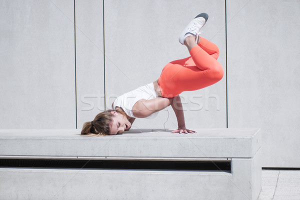 Young Woman in Hip Hop Dance Pose on Bench Stock photo © stryjek