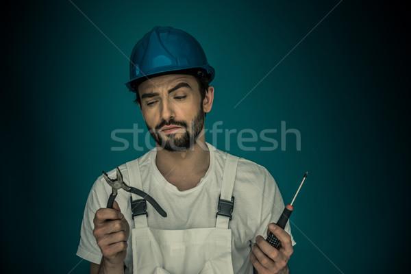 Workman standing eyeing his tools Stock photo © stryjek