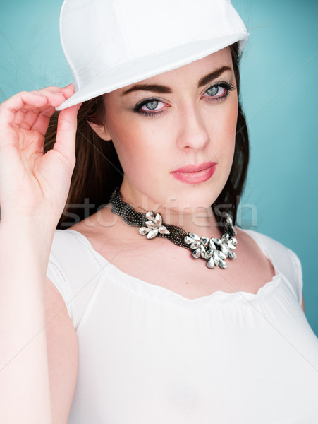 Fashionable Pretty Young Woman Looking at Camera Stock photo © stryjek