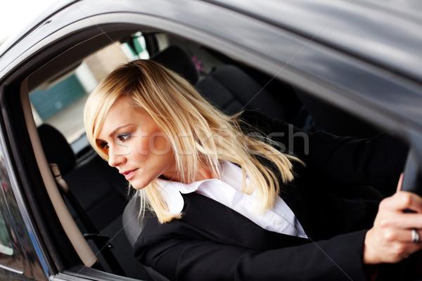 Attractive woman reversing a car Stock photo © stryjek