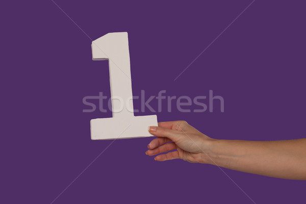 Female hand holding up the number 1 from the right Stock photo © stryjek