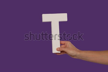 Female hand holding up the letter I from the right Stock photo © stryjek
