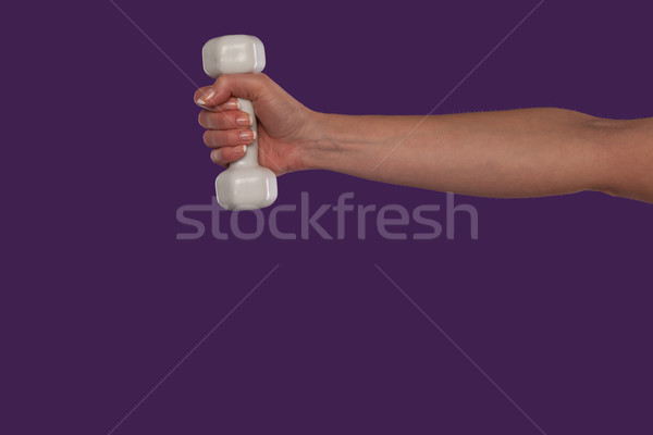 Female hand holding a small dumbbell Stock photo © stryjek