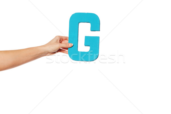 hand holding up the letter G from the left Stock photo © stryjek
