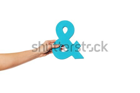 hand holding up an ampersand from the top Stock photo © stryjek