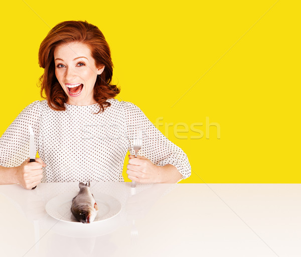 Studio shot of hungry woman on yellow background Stock photo © stryjek
