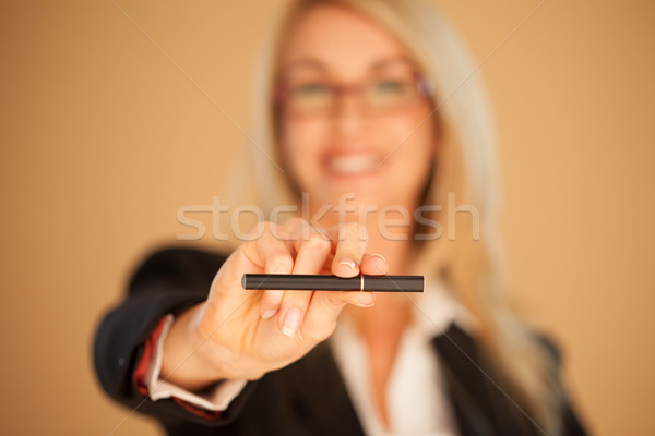 Woman offering a cigarette Stock photo © stryjek