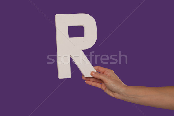 Female hand holding up the letter R from the right Stock photo © stryjek