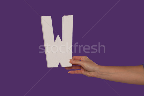 Female hand holding up the letter W from the right Stock photo © stryjek