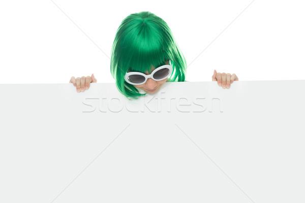 Aranyos fiatal lány zöld paróka tart felirat Stock fotó © stryjek
