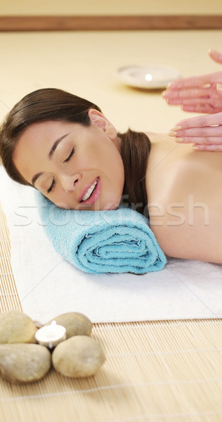 Pretty woman enjoying a lava stone massage Stock photo © stryjek