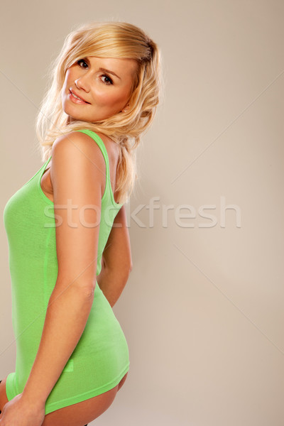 Sexy blonde vrouw kort shirt groene tonen Stockfoto © stryjek