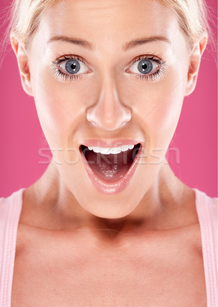 Woman looking surprised Stock photo © stryjek
