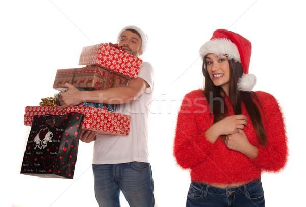 Fiatal pér karácsony ajándékok nő áll mosolyog Stock fotó © stryjek