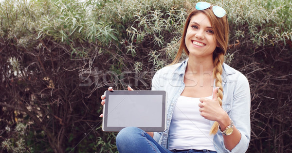 Cheerful Woman with Tablet Against Tall Grasses Stock photo © stryjek