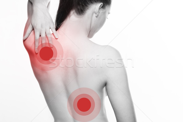 Young woman with shoulder and back pain Stock photo © stryjek