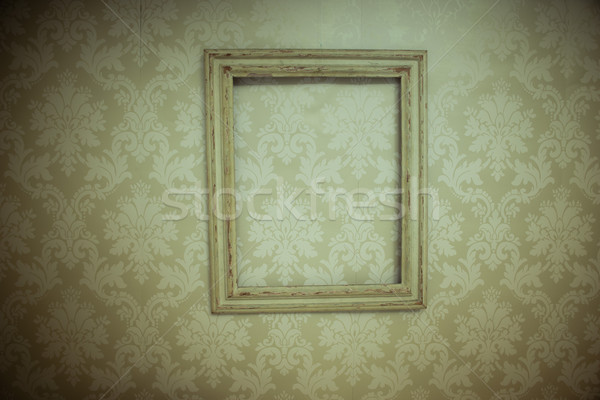 Empty vintage wooden frame hanging on wallpaper Stock photo © stryjek