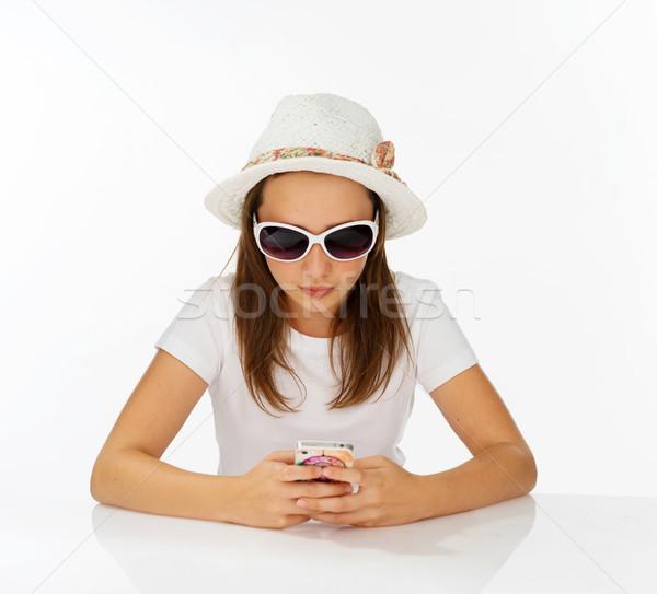 Divatos lány küldés sms trendi kalap Stock fotó © stryjek