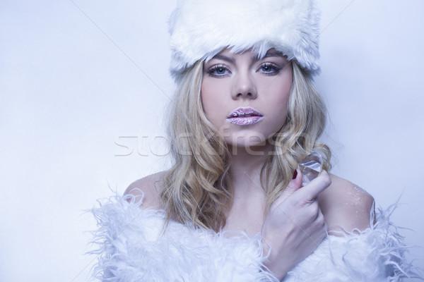 Beautiful serene woman in cool blue winter fashion Stock photo © stryjek