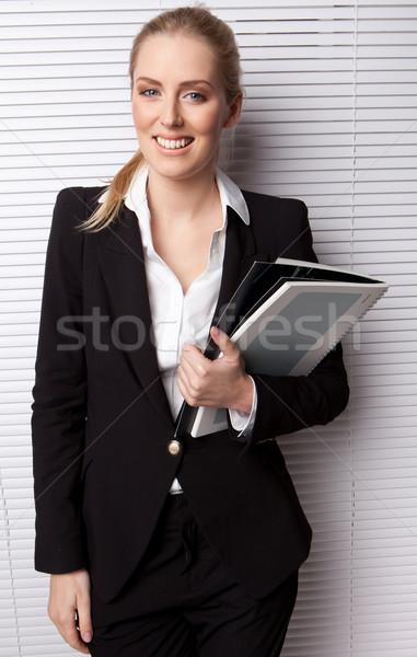 Smiling Business Secretary Holding File Stock photo © stryjek