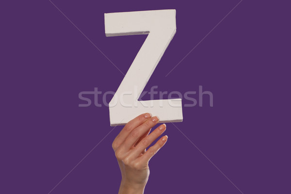 Female hand holding up the letter Z from the bottom Stock photo © stryjek