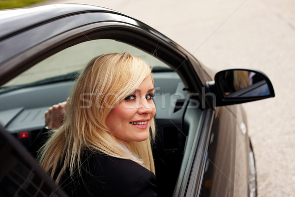 Attractive blonde female driver Stock photo © stryjek