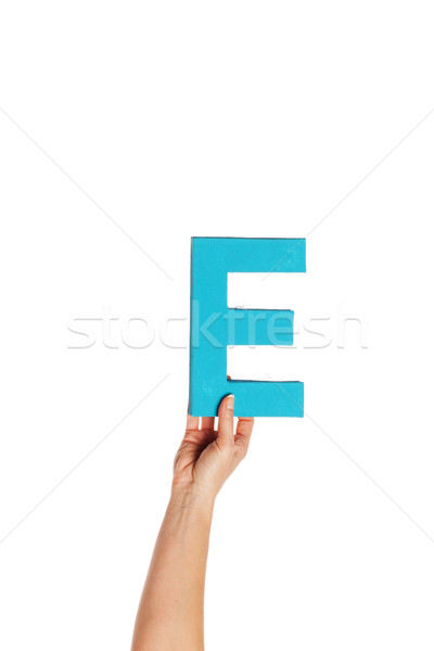 hand holding up the letter E from the bottom Stock photo © stryjek