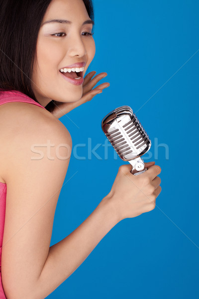 Laughing Asian woman with a microphone Stock photo © stryjek