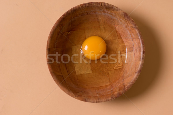 Fresh raw egg in a mixing bowl Stock photo © stryjek