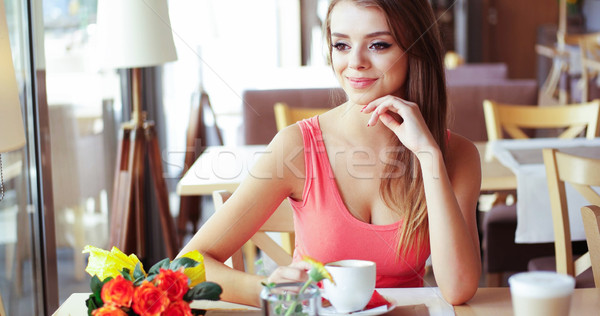 Smiling Young Woman in Sunny Cafe Stock photo © stryjek