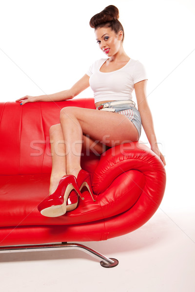 Pert Pinup Girl On Red Sofa Stock photo © stryjek