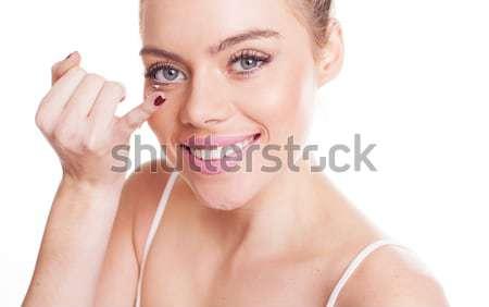 Happy woman pointing upwards Stock photo © stryjek