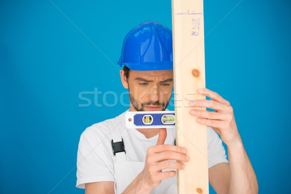 Workman using a spirit level Stock photo © stryjek