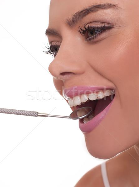 Mosolygó nő tart fogászati tükör száj szemben Stock fotó © stryjek