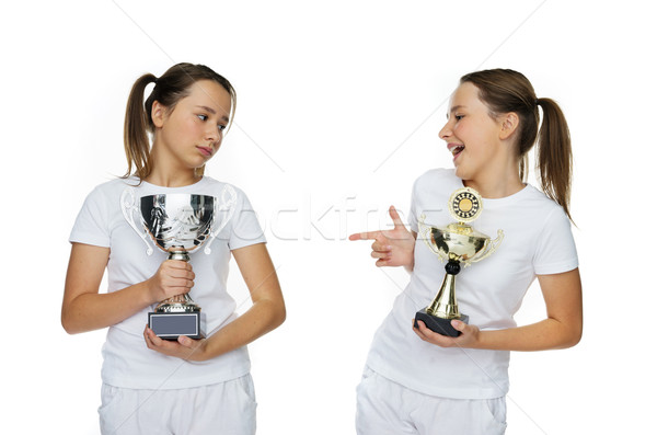 Two Young Pretty Girls Holding Trophies Pose Stock photo © stryjek