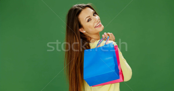 Happy female shopper carrying her purchases Stock photo © stryjek