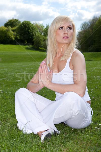 Woman meditating and looking to heaven Stock photo © stryjek