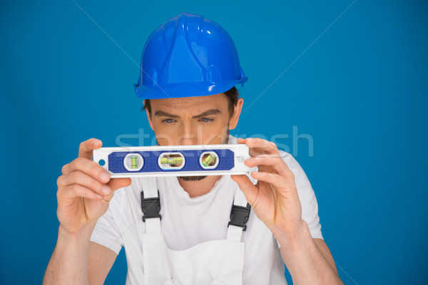 Workman viewing a spirit level Stock photo © stryjek