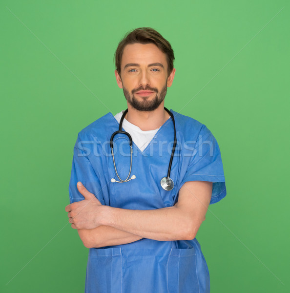 Confident friendly young male doctor or nurse Stock photo © stryjek