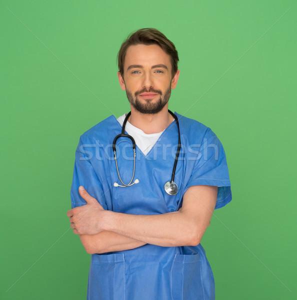 Amigável jovem médico do sexo masculino enfermeira em pé estetoscópio Foto stock © stryjek