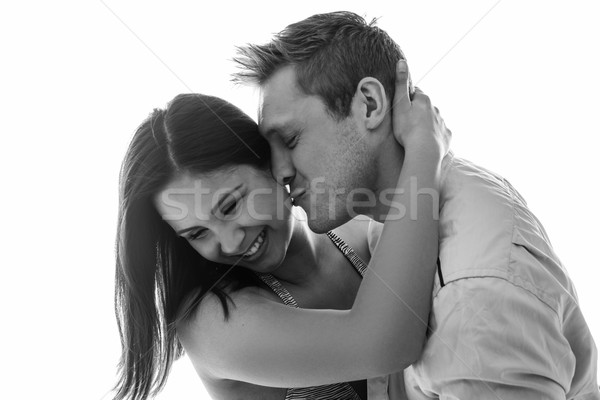 Young man trying to kiss a beautiful woman Stock photo © stryjek