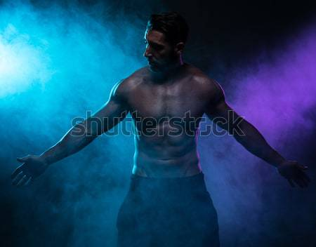 Shirtless Athletic Man Looking Down with Spotlight Stock photo © stryjek