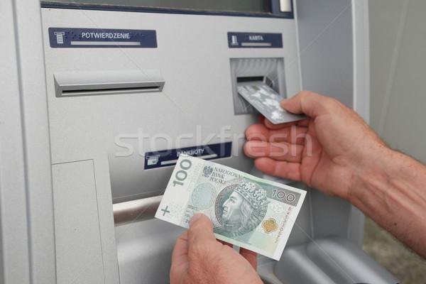 hand of a man using banking machine Stock photo © stryjek